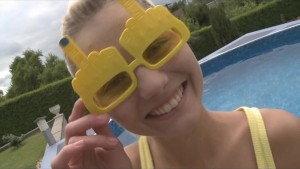 Blond teen dildoing her shaved pussy by the pool
