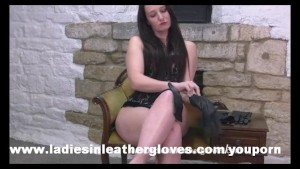 Sexy Milf decides to put on two pairs of sexy leather gloves
