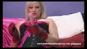 Horny blonde toys her wet pussy then licks her gloves clean