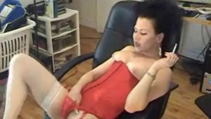 Brunette slut on her lingerie masturbating while smoking