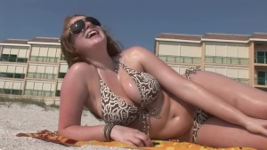 Brunette with big tits on the beach - DreamGirls