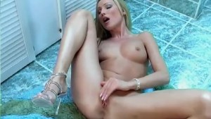 Horny blonde girl fucks herself in the bathroom - Captain Willy