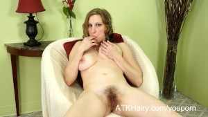Busty Sausha Packer shows off her hairy pussy
