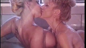 Two hot milf are taking a bath together - Coast to Coast