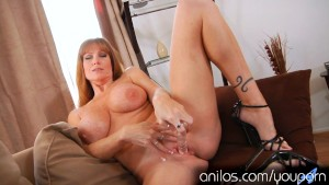 Busty housewife puts dildo in wet pussy