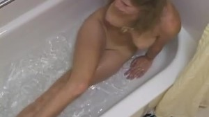 Young sister spied on neighbor while she masturbated in the bath tub.