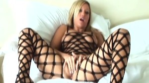 Big boobed Memphis masturbates in a bodystocking