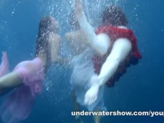 3 girls stripping in the sea