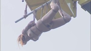 Japanese babe fucked and gets suspended from a crane
