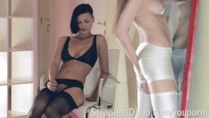 Innocent sex doll pounded with the strapon in front of the mirror