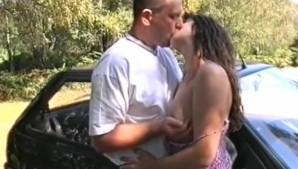 Mature couple having sex outside