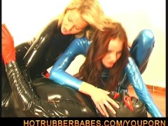 Lesbian couple in tight latex dress