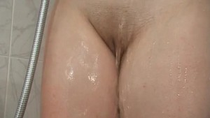 young big naturals takes a shower