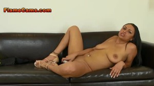 Ebony girl with big tits slides a dildo deep into her pussy