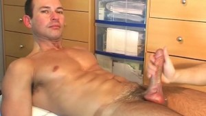 A sexy swimmer guy serviced by us: get wanked his huge cock by a guy !