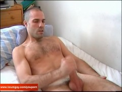 A real sexy swimmer guy get wanked is very huge cock by a guy in spite of him !