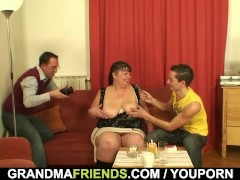 Fat mature swallows two dicks