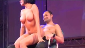 fetish babe with big naturals on show stage