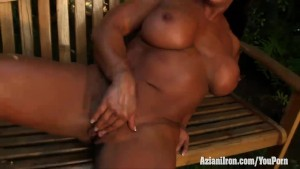 Aziani Iron Amber Deluca flexing her biceps and huge back