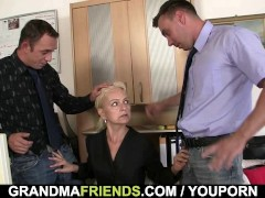 Picture Two dudes share old blonde in the office