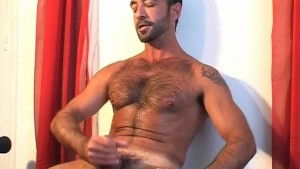 This arab guy get wanked his huge cock in spite of him!