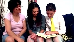 Naughty lesbian teacher watches two teen students teasing pussies with toys