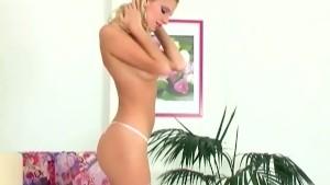 Skinny babe in panties pink stockings and heels