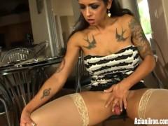 Buff MILF wearing stockings fucks herself to orgasm