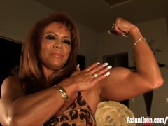 Mature female bodybuilder DD plays with her big clit