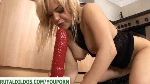 Busty babe fucks a big red dildo and squirts