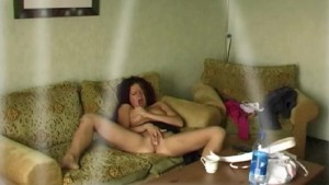 Long hair woman masturbating in living room