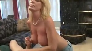 Mature Blonde Gives Guy An Awesome Hand Job