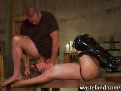 Female sex slave in knee high boots blindfolded with cock stuffed in her mouth