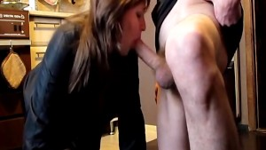 Real housewife giving a hot blowjob in the kitchen