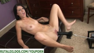 Brunette with a brutal dildo fucking machine