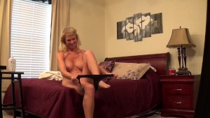 Hot blonde dressing in bedroom for camera