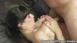 Big titted vixen Natalie Minx sucks and tittyfucks veiny cock for a creamy facial