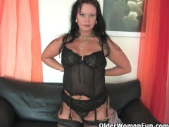 Picture Chubby soccer mom in stockings works her har...