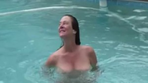 Wife having sex with husband by swimming pool