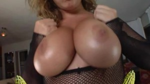 Big titty slut gets fucked in her fishnet outfit