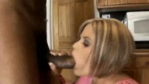 Babe Shoves That Big Black Cock Into Her Mouth