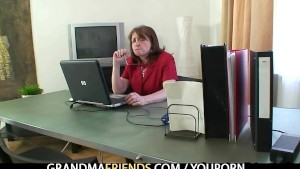 Granny takes two cocks in the office
