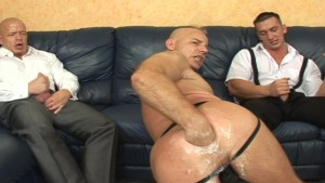 Nothing entertains your party guests more than having a dude shove a big ol' black dildo up his anus
