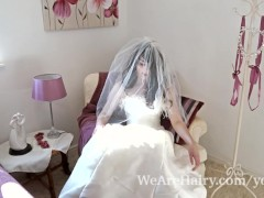 Hairy woman Melanie Kate takes off wedding dress