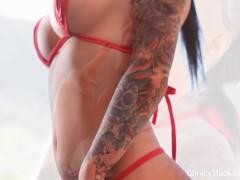 Christy Mack in Hot Red String Bikini