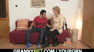 Blonde granny jumps on his young cock
