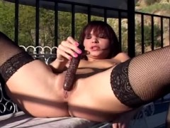 Masturbation outdoors in black fishnet stockings