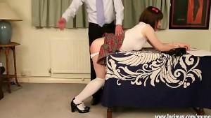 Cute crossdresser Schoolgirl gets hard spanking over desk for cheating