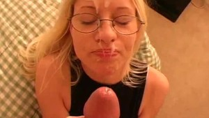 Handjob from amateur blonde in glasses