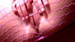Pigtailed cutie fingering in fishnet pantyhose